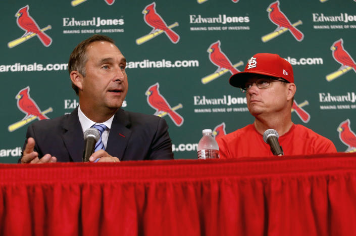 """FILE - St. Louis Cardinals President of Baseball Operations John Mozeliak, left, answers questions after the team announced Mike Shildt, right, as manager, at Busch Stadium in St. Louis.,in this Tuesday, Aug. 28, 2018, file photo. The Cardinals fired former National League manager of the year Mike Shildt over organizational differences Thursday, Oct. 14, 2021, just one week after St. Louis lost to the Los Angeles Dodgers on a walk-off homer in the wild-card game. Mozeliak said the firing was """"something that popped up recently,"""" but he refused to expand on what he called """"philosophical differences"""" between Shildt, the coaching staff and the front office. (Christian Gooden/St. Louis Post-Dispatch via AP, File)"""