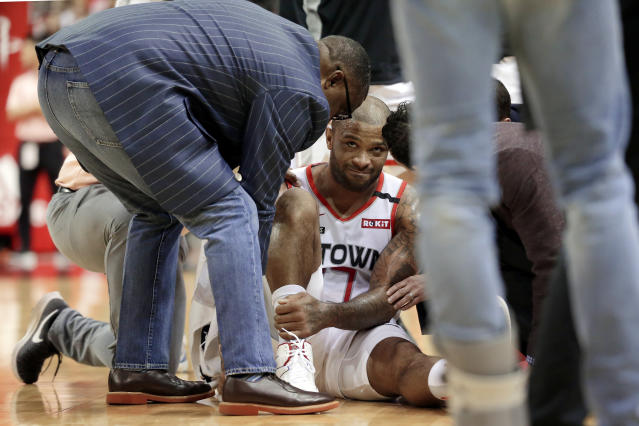 Houston Rockets forward PJ Tucker (17) is tended to on the court after sustaining an injury on a play during the first half of an NBA basketball game against the Minnesota Timberwolves, Saturday, Jan. 11, 2020, in Houston. Tucker left the court afterward for the locker room. (AP Photo/Michael Wyke)