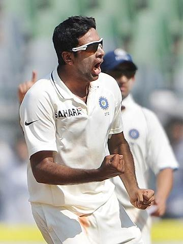 Ravichandran Ashwin celebrates after taking the wicket of Adrian Barath during the first day of the third Test match between India and West Indies at the Wankhede stadium in Mumbai. (Punit Paranjpe/AFP/Getty Images)