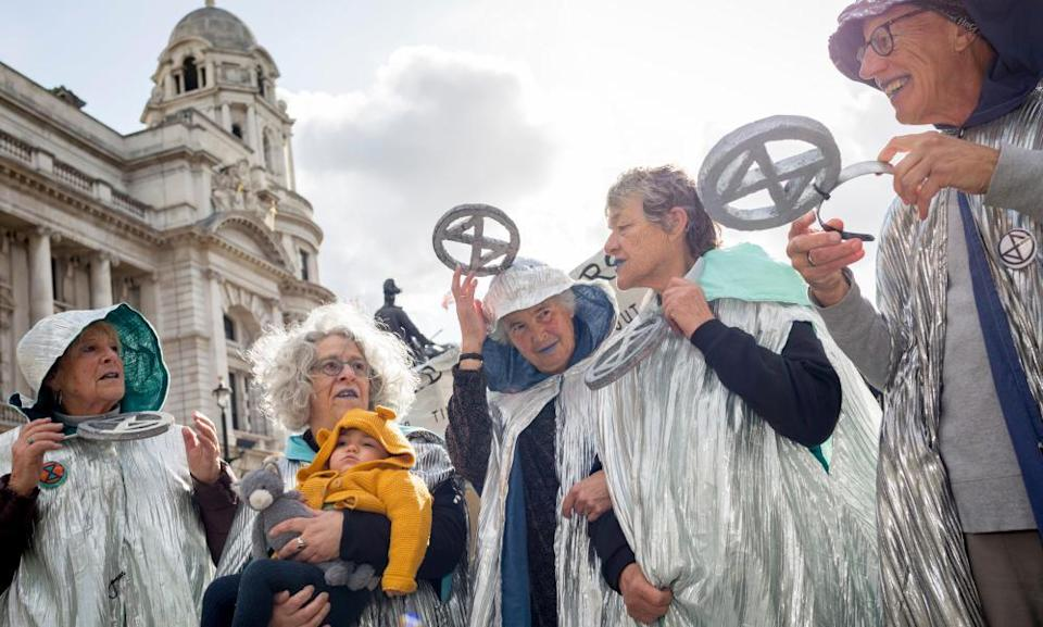 Older environmental activists protest about climate change in London.