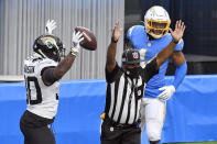 Jacksonville Jaguars running back James Robinson, left, celebrates after scoring against the Los Angeles Chargers during the first half of an NFL football game Sunday, Oct. 25, 2020, in Inglewood, Calif. (AP Photo/Kyusung Gong)