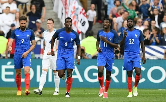 Midfielder Paul Pogba, second left, and Ousmane Dembele, third left, appear for France in a recent international friendly against England