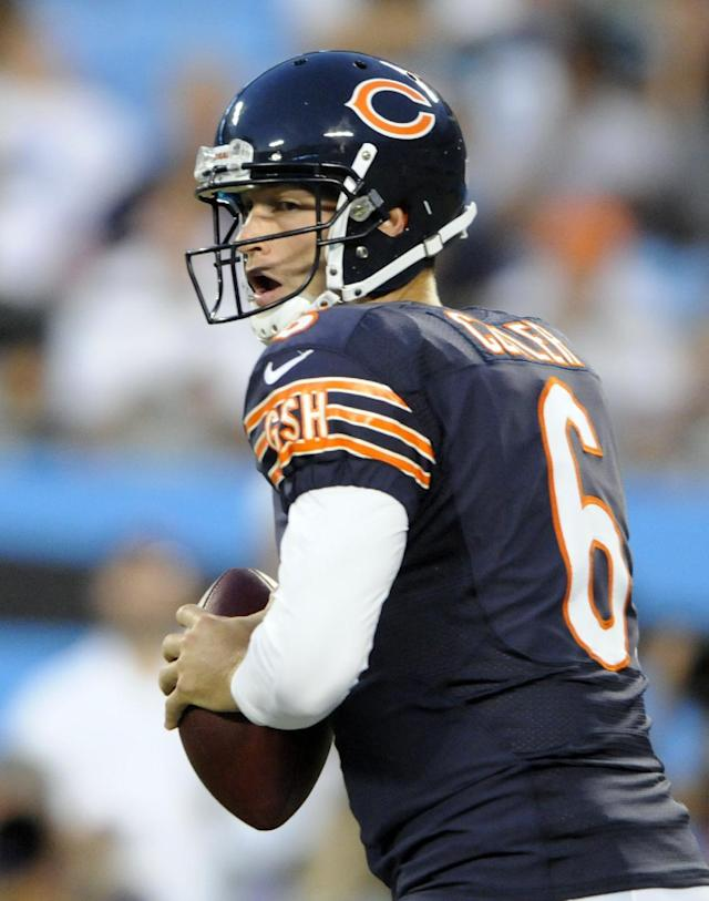Chicago Bears quarterback Jay Cutler looks to pass against the Carolina Panthers during the first half of a preseason NFL football game in Charlotte, N.C., Friday, Aug. 9, 2013. (AP Photo/Mike McCarn)