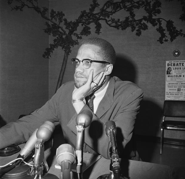 "File - In this May 22, 1964, file photo, civil rights leader Malcolm X speaks during a press conference in Chicago. ""Who Killed Malcolm X?"" currently streaming on Netflix dives into questions surrounding his 1965 assassination and allegations of a botched investigation. (AP Photo/Edward Kitch, File)"