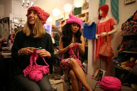 Jayna Zweiman and Krista Suh take part in the Pussyhat social media campaign they created to provide pink hats for protesters in the women's march in Washington, D.C., the day after the presidential inauguration, in Los Angeles, California, U.S., January 13, 2017. REUTERS/Lucy Nicholson