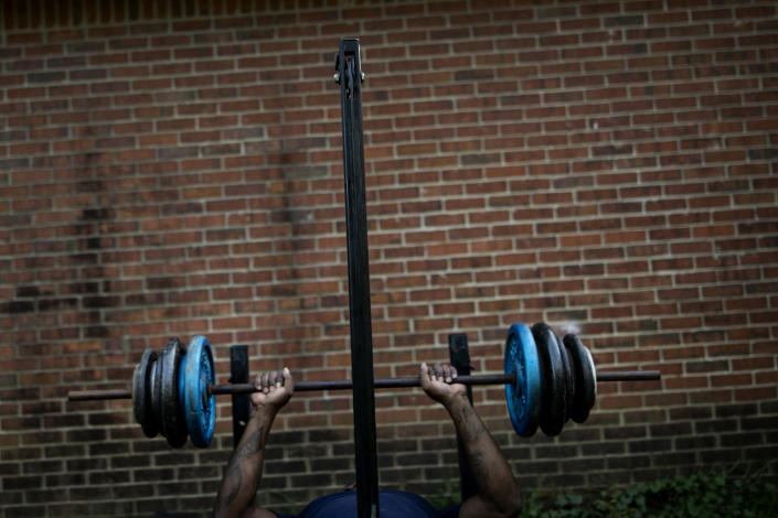 La Jarvis D. Love lifts weights at a makeshift outdoor gym down near his home in Senatobia, Miss., Sunday, June 9, 2019. Love says he works out to assuage memories of alleged sexual abuse. (AP Photo/Wong Maye-E)