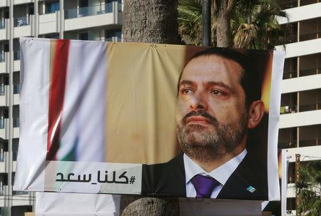 A poster depicting Lebanon's Prime Minister Saad al-Hariri, who has resigned from his post, is seen in Beirut
