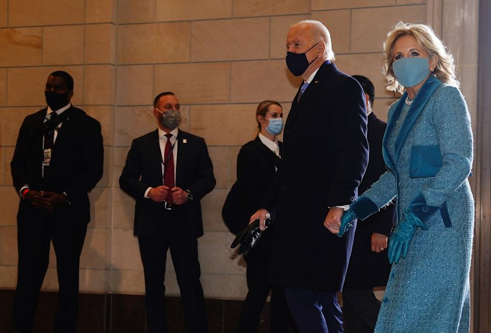 President-elect Joe Biden (C) and incoming US First Lady Jill Biden (R) arrive at the East Front of the US Capitol for his inauguration ceremony to be the 46th President of the United States in Washington, DC, on January 20, 2021. (Photo by JIM LO SCALZO / POOL / AFP) (Photo by JIM LO SCALZO/POOL/AFP via Getty Images)