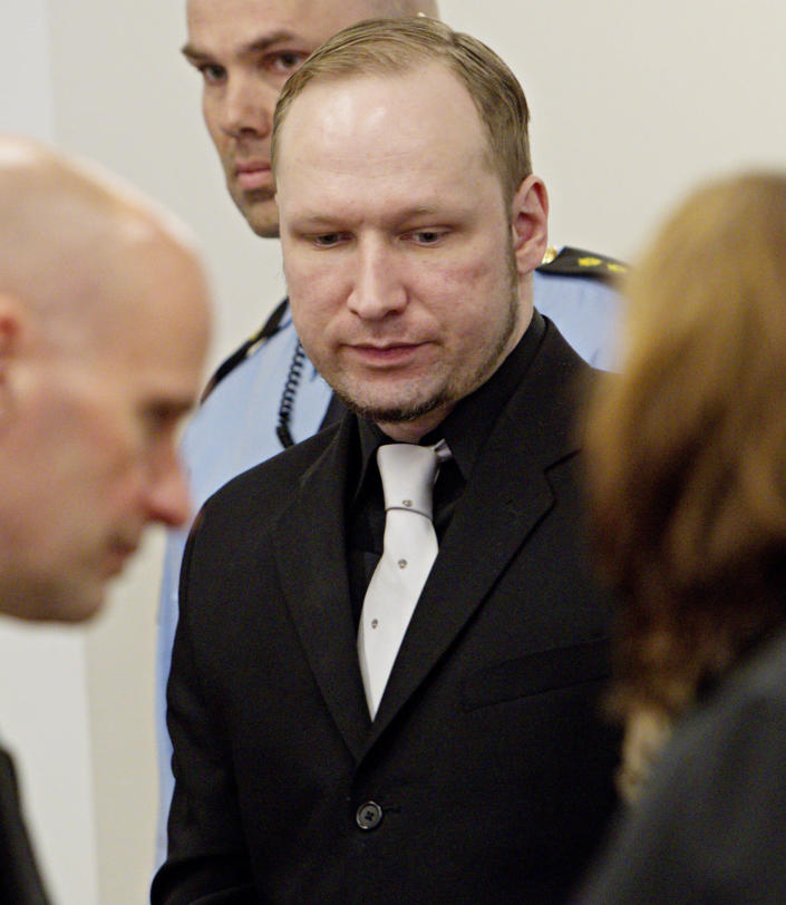 Defendant Anders Behring Breivik and defence lawyer Geir Lippestad, left, in court at the start of the 5th day of his mass killing trial in Oslo, Norway, Friday April 20, 2012. Confessed mass murderer Breivik testified Thursday in a chilling account of his preparations for the massacre of 77 people. (AP Photo / Stian Lysberg Solum, POOL)