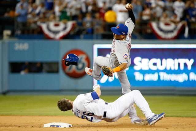Ruben Tejada of the New York Mets is hit by a slide by Chase Utley of the Los Angeles Dodgers in the seventh inning of game two of the National League Division Series at Dodger Stadium on October 10, 2015 in Los Angeles, California (AFP Photo/Sean M. Haffey)
