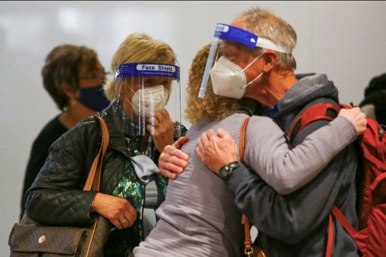<p>Millions of Americans are reuniting after months apart – despite health warnings not to travel as the pandemic rages on</p> (Reuters)