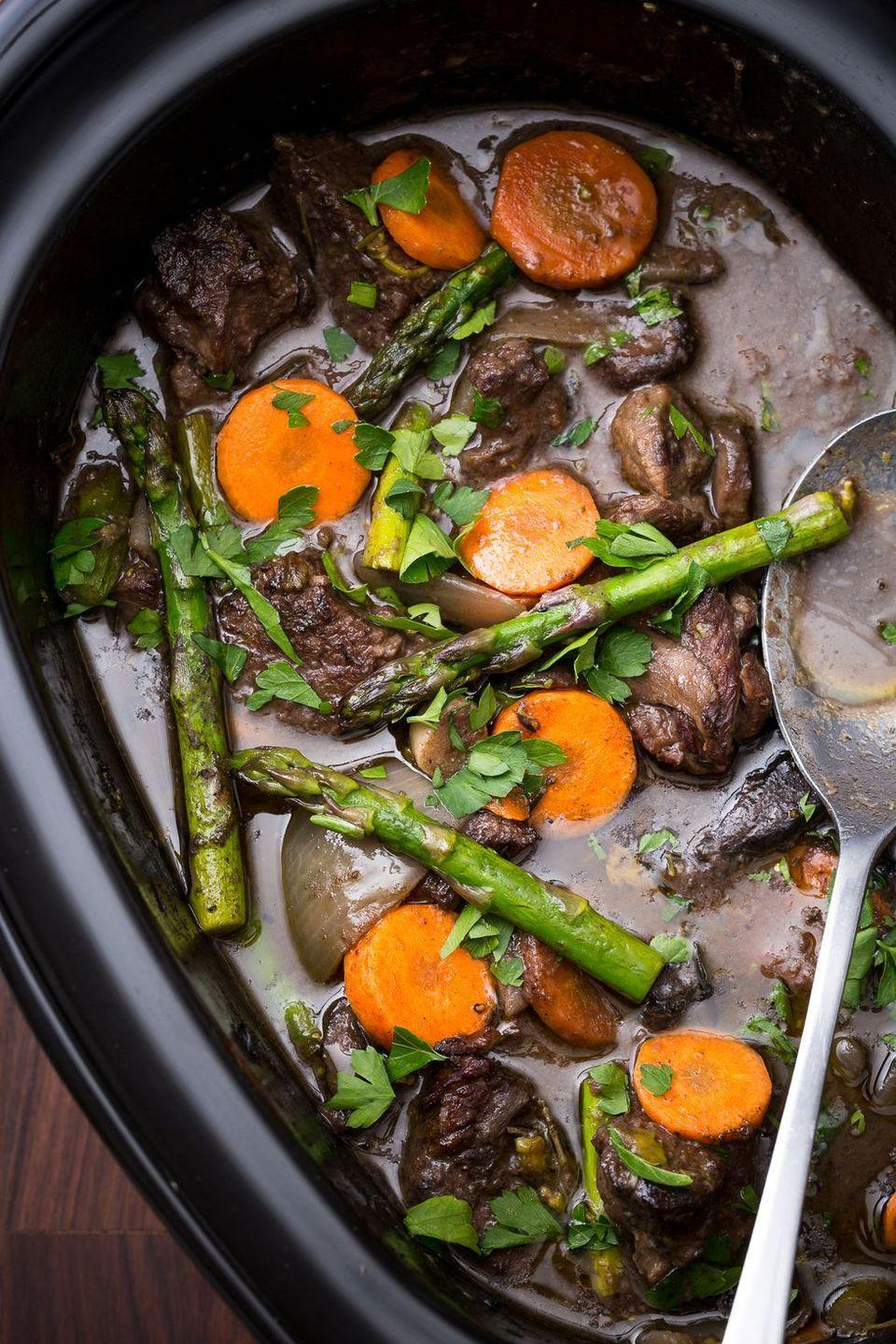 "<p>Add some freshness to the beefy classic with this insanely delish slow cooker dinner.</p><p>Get the <a href=""https://www.delish.com/uk/cooking/recipes/a28830287/slow-cooker-beef-bourguignon/"" rel=""nofollow noopener"" target=""_blank"" data-ylk=""slk:Slow Cooker Spring Beef Bourguignon"" class=""link rapid-noclick-resp"">Slow Cooker Spring Beef Bourguignon</a> recipe.</p>"