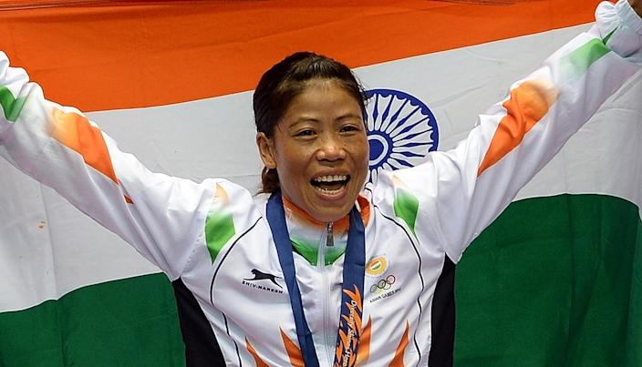 Mary Kom celebrates in Incheon on October 1, 2014 after winning the Asian Games women's flyweight (48-51kg) boxing final match against Kazakhstan's Shekerbekova Zhaina (AFP Photo/Indranil Mukherjee)
