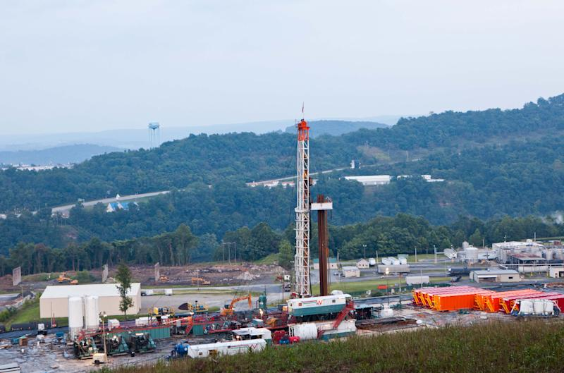 FILE - A natural gas well operated by Northeast Natural Energy is seen in this Aug. 6, 2011 file photo. For decades, coal from West Virginia's vast deposits was mined and hauled off without leaving behind the benefit of a lasting trust fund financed by the state's best-known commodity. In 2013 a new bonanza in the natural gas fields has state leaders proposing to create an oil and natural gas trust fund for future generations. (AP Photo/David Smith)