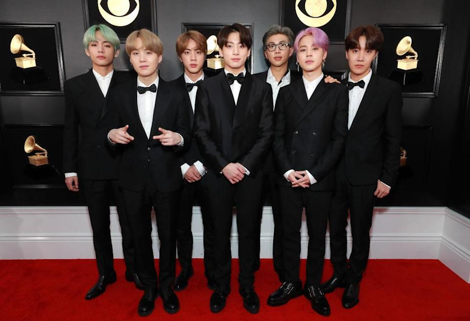 <p>The guys of BTS were handsome in sleek suits and pastel-colored hair, as they prepared to present an award. </p>