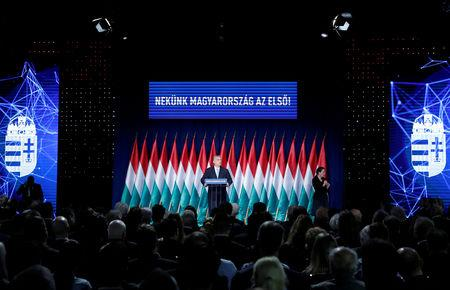 "Hungarian Prime Minister Viktor Orban delivers his annual state of the nation speech in Budapest, Hungary, February 10, 2019. Banner reads ""Hungary first!"". REUTERS/Bernadett Szabo"