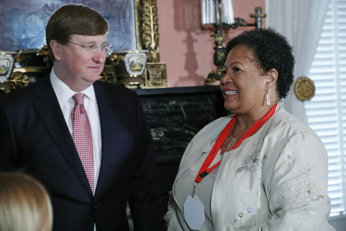 Mississippi Republican Gov. Tate Reeves, left, speaks with Reena Evers, daughter of the slain civil rights activist Medgar Evers and Myrlie Evers-Williams, after signing a bill to retire the last state flag in the United States with the Confederate battle emblem, at the Governor's Mansion in Jackson, Miss., Tuesday, June 30, 2020. With the bill's signature, the flag lost its official status. (AP Photo/Rogelio V. Solis, Pool)