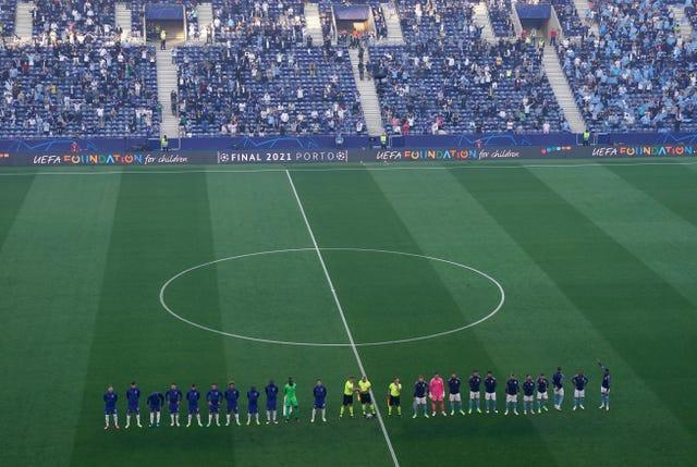 Chelsea and Manchester City players line up before the game