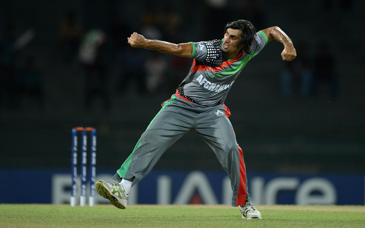 COLOMBO, SRI LANKA - SEPTEMBER 21:  Shapoor Zadran of Afghanistan celebrates dismissing Craig Kieswetter of England during the ICC World Twenty20 2012 Group A match between England and Afghanistan at R. Premadasa Stadium on September 21, 2012 in Colombo, Sri Lanka.  (Photo by Gareth Copley/Getty Images)