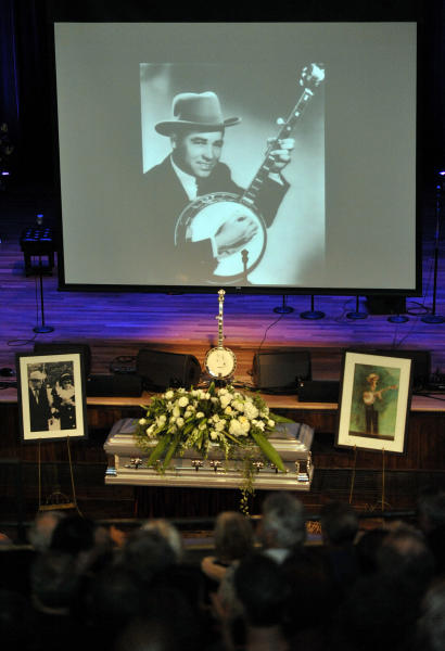 A photo of a young Earl Scruggs is projected during his funeral service at the Ryman Auditorium on Sunday, April 1, 2012, in Nashville, Tenn. Scruggs died Wednesday, March 28, 2012. He was 88. (AP Photo/Joe Howell, Pool)