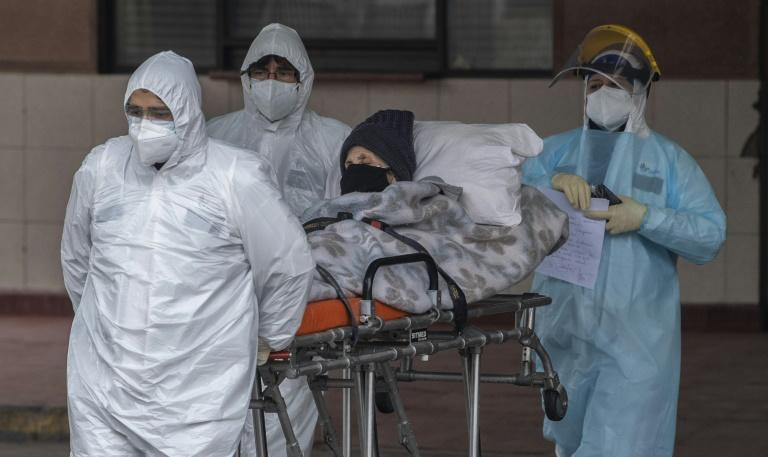 Capital city Santiago now has the fourth-largest number of confirmed cases of any city in the world; pictured are health staff transferring a patient with symptoms of COVID-19 at San Jose Hospital in Santiago amid the novel coronavirus pandemic