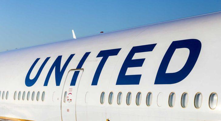 """The side of a United Airlines (UAL) plane with """"united"""" written above passenger windows. Represents airline stocks."""