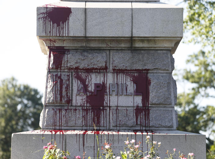 Paint appears on the statue of Confederate General A. P. Hill as it was vandalized overnight in Richmond, Va., Wednesday, Aug. 22, 2018. The vandalism comes after protesters at North Carolina's flagship university toppled a Confederate monument in the heart of campus earlier this week. Richmond has been debating what to do with its most prominent Confederate monuments along Monument Avenue in a different part of the city. The Hill statue hasn't been part of that discussion.(AP Photo/Steve Helber)