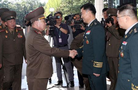North Korean Lieutenant General An Ik San is greeted by South Korean Major General Kim Do-gyun before a meeting at the Peace House of the border village of Panmunjom, South Korea, July 31, 2018.    Yonhap via REUTERS