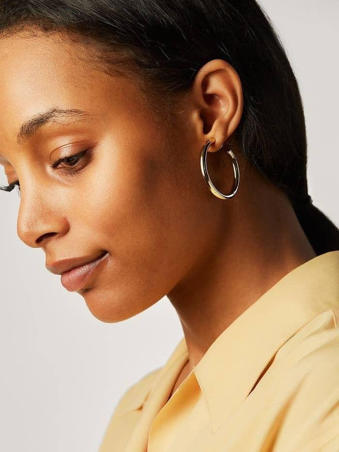 """These hoops are a great size and will match any outfit. Plus, they're high-quality and will last for a long time.<br /><br /><strong>Promising review:</strong>""""These hoops are perfect! They're beautiful, lightweight, and high quality. Plus, they're comfortable to wear and non-irritating to my sensitive ears."""" — Christine<br /><br /><strong>Get them from Ana Luisa for<a href=""""https://go.skimresources.com?id=38395X987171&xs=1&url=https%3A%2F%2Fwww.analuisa.com%2Fproducts%2Ftimeless-medium-hoop&xcust=HPSplurgeWorthy60771eb6e4b01654bb7978a0"""" target=""""_blank"""" rel=""""nofollow noopener noreferrer"""" data-skimlinks-tracking=""""5753950