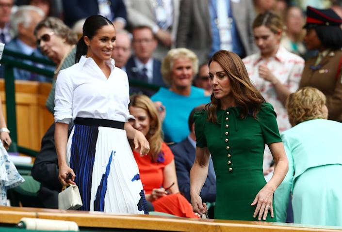 The Duchess of Sussex and the Duchess of Cambridge in the Royal Box ahead of the Wimbledon women's final between Serena Williams of the U.S. and Romania's Simona Halep.