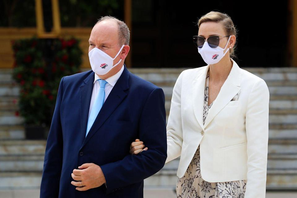 <p>Prince Albert knows first-hand what it's like to contract coronavirus. He recovered from his own bout of COVID-19 in April. Here he and Princess Charlene are seen wearing protective face masks at the inauguration of the new Place du Casino in Monaco.</p>