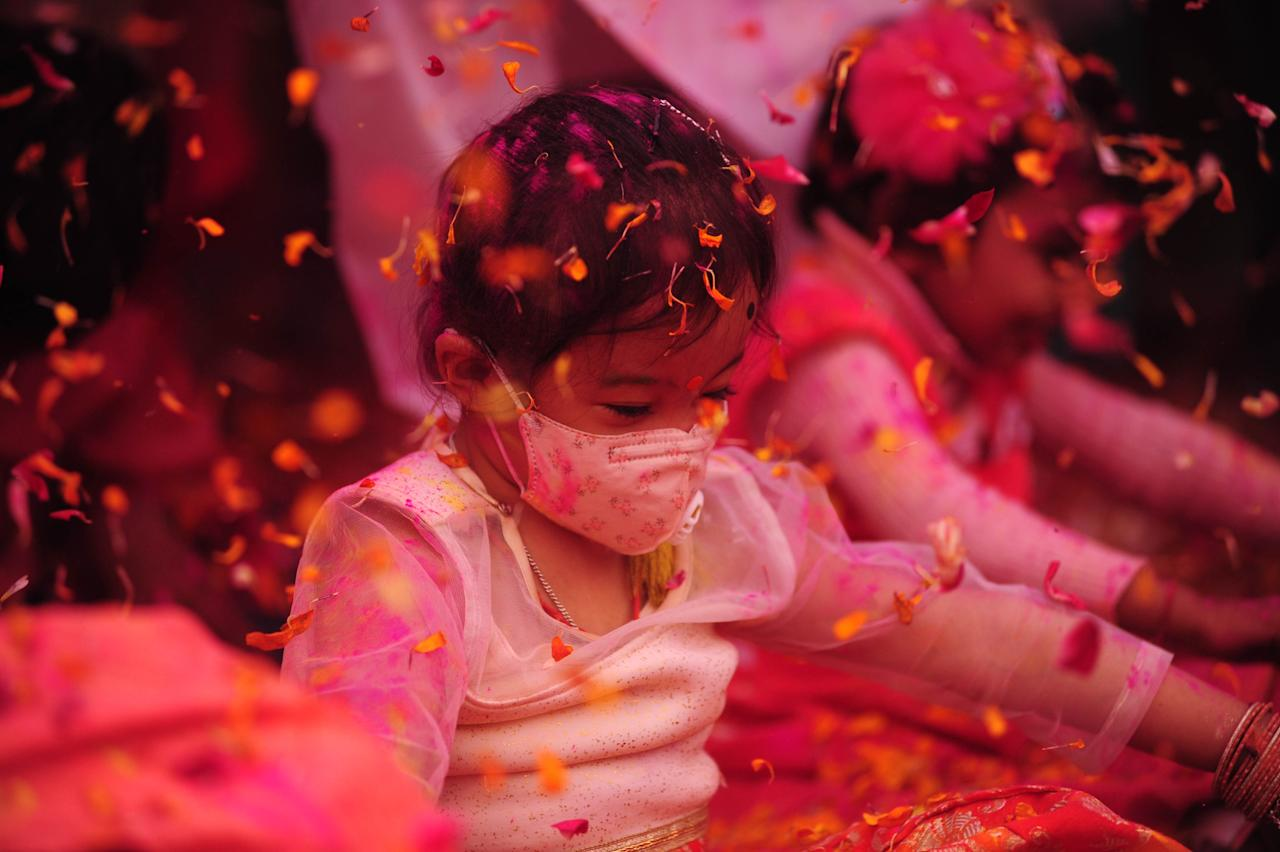 A girl in a face mask takes part in an event to celebrate the Hindu festival of Holi for the children with cerebral palsy , organised by The Trishla Foundation , in Allahabad on March 6,2020. (Photo by Ritesh Shukla/NurPhoto via Getty Images)