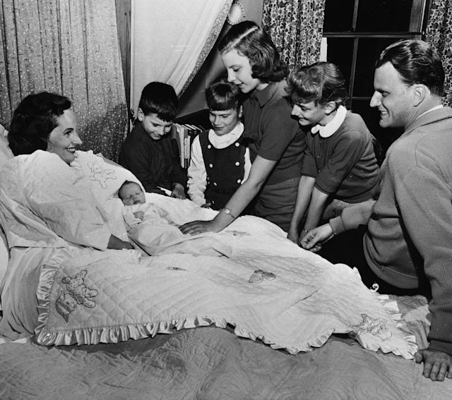 <p>Rev. Billy Graham says goodbye to his wife, Ruth, and their five children on Jan. 15, 1958, before leaving on a crusade in eight Latin American countries. (Photo: AP) </p>