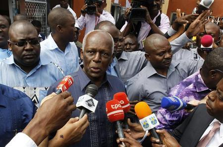 Angola's President Jose Eduardo dos Santos addresses the media after casting his vote during national elections in the capital Luanda