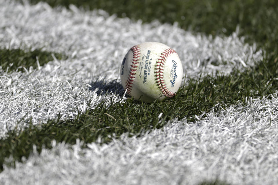 A baseball rests on the field prior to an opening day baseball game between the New York Yankees and the Baltimore Orioles at Yankee Stadium, Thursday, March 28, 2019, in New York. (AP Photo/Julio Cortez)