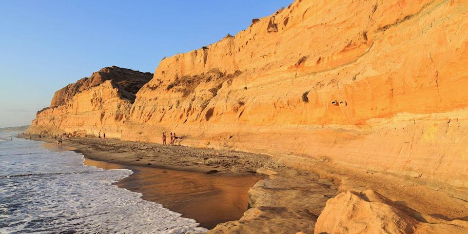 """<p><span><strong>Best for Cliff Views </strong></span></p><p>Sandstone cliffs more than 300-feet high provide a dramatic backdrop as you take a dip in the Pacific Ocean or a walk along the golden-colored sand while in <a href=""""https://go.redirectingat.com?id=74968X1596630&url=https%3A%2F%2Fwww.tripadvisor.com%2FAttraction_Review-g60750-d531826-Reviews-Torrey_Pines_State_Beach-San_Diego_California.html&sref=https%3A%2F%2Fwww.redbookmag.com%2Flife%2Fg37132327%2Ftop-california-beach-vacations%2F"""" rel=""""nofollow noopener"""" target=""""_blank"""" data-ylk=""""slk:Torrey Pines State Beach"""" class=""""link rapid-noclick-resp"""">Torrey Pines State Beach</a>, located north of La Jolla. There's also great birding along the shoreline — keep an eye out for osprey, brown pelicans, and royal terns. </p><p><strong><em>Where to Stay: </em></strong><a href=""""https://go.redirectingat.com?id=74968X1596630&url=https%3A%2F%2Fwww.tripadvisor.com%2FHotel_Review-g32578-d77427-Reviews-San_Diego_Marriott_La_Jolla-La_Jolla_San_Diego_California.html&sref=https%3A%2F%2Fwww.redbookmag.com%2Flife%2Fg37132327%2Ftop-california-beach-vacations%2F"""" rel=""""nofollow noopener"""" target=""""_blank"""" data-ylk=""""slk:San Diego Marriott La Jolla"""" class=""""link rapid-noclick-resp"""">San Diego Marriott La Jolla</a>, <a href=""""https://go.redirectingat.com?id=74968X1596630&url=https%3A%2F%2Fwww.tripadvisor.com%2FHotel_Review-g32578-d77401-Reviews-Inn_by_the_Sea-La_Jolla_San_Diego_California.html&sref=https%3A%2F%2Fwww.redbookmag.com%2Flife%2Fg37132327%2Ftop-california-beach-vacations%2F"""" rel=""""nofollow noopener"""" target=""""_blank"""" data-ylk=""""slk:Inn by the Sea at La Jolla"""" class=""""link rapid-noclick-resp"""">Inn by the Sea at La Jolla</a></p>"""