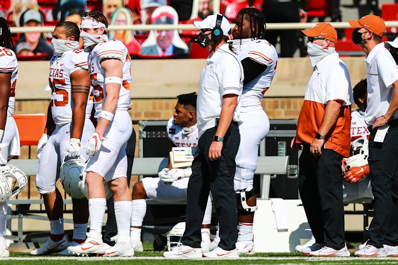 LUBBOCK, TEXAS - SEPTEMBER 26: Head coach Tom Herman of the Texas Longhorns, center, looks on during the first half of the college football game against the Texas Tech Red Raiders on September 26, 2020 at Jones AT&T Stadium in Lubbock, Texas. (Photo by John E. Moore III/Getty Images)