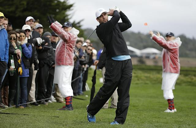 Green Bay Packers quarterback Aaron Rodgers hits on the 18th hole of the Pebble Beach Golf Links during the third round of the AT&T Pebble Beach Pro-Am golf tournament Saturday, Feb. 8, 2014, in Pebble Beach, Calif. (AP Photo/Eric Risberg)