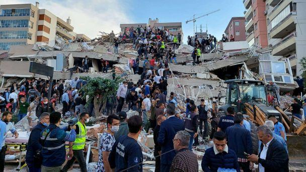 PHOTO: Locals and officials search for survivors at a collapsed building after a strong earthquake struck the Aegean Sea and was felt in both Greece and Turkey, where some buildings collapsed in the coastal province of Izmir, Turkey, Oct. 30, 2020. (Tuncay Dersinlioglu/Reuters)