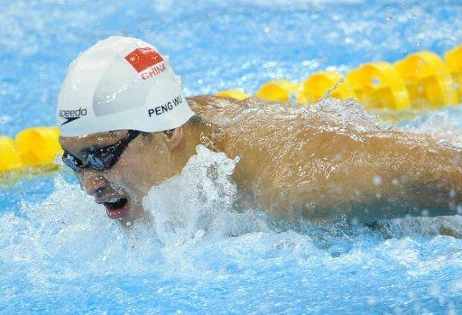 China's Wu Peng touched the wall to win the 200-meter butterfly in a time of one minute, 56.69 seconds
