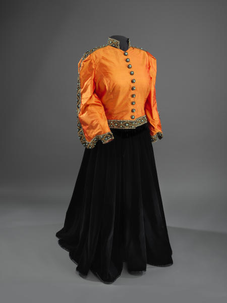 This undated handout photo provided by the National Museum of American History shows a Shantung silk jacket, redesigned in 1993, and black velvet skirt worn by Marian Anderson during her historic performance on the Lincoln Memorial in Washington in 1939. For the first time, Anderson's orange-and-black blouse and skirt ensemble that she wore during her historic performance on the Lincoln Memorial steps 75 years ago will go on display at the Smithsonian. Anderson was a groundbreaking opera singer but was kept out of Washington's Constitution Hall because she was black, and Eleanor Roosevelt invited her to perform at the Lincoln Memorial instead. The concert attire is part of a collection being donated to the National Museum of African American History and Culture by a member of Anderson's extended family to mark the anniversary of Anderson's concert on Wednesday. It will be displayed beginning Tuesday and will remain on view until September. (AP Photo/Hugh Talman)