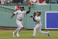 New York Yankees center fielder Estevan Florial catches a fly ball hit by Boston Red Sox's Enrique Hernandez as right fielder Greg Allen backs him up during the first inning of a baseball game at Fenway Park, Thursday, July 22, 2021, in Boston. (AP Photo/Elise Amendola)