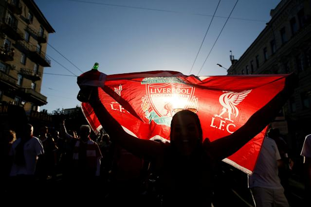 Soccer Football - Champions League Final - Real Madrid v Liverpool - Kiev, Ukraine - May 26, 2018 Liverpool fan raises a flag as they gather in Kiev before the match REUTERS/Valentyn Ogirenko TPX IMAGES OF THE DAY