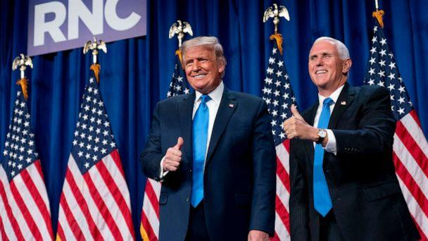 PHOTO: President Donald Trump and Vice President Mike Pence stand on stage during the first day of the 2020 Republican National Convention in Charlotte, N.C., Aug. 24, 2020. (Andrew Harnik/AP)
