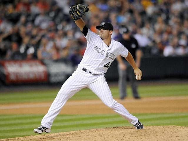 Colorado Rockies relief pitcher Rex Brothers throws in the seventh inning of a baseball game against the Washington Nationals on Tuesday, July 22, 2014, in Denver. (AP Photo/Chris Schneider)