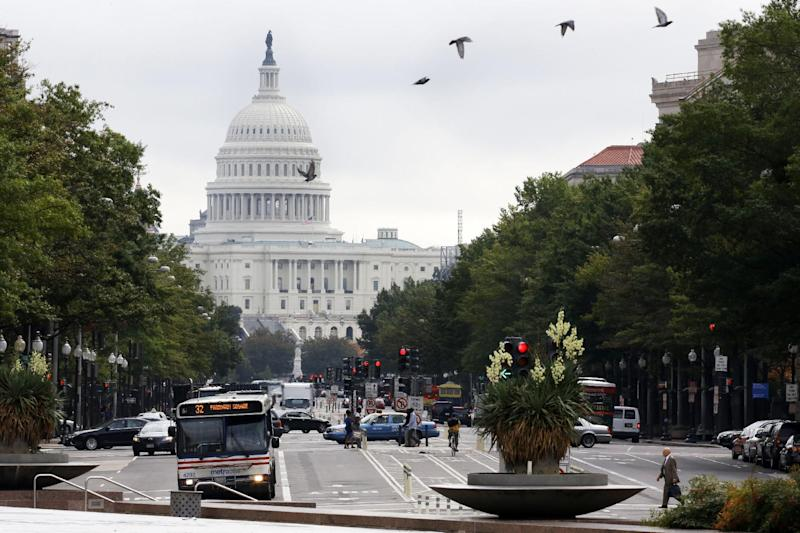 "Birds fly across Pennsylvania Avenue NW with the Capitol in the background in Washington, Wednesday, Oct. 3, 2012. Pennsylvania Avenue, sometimes called ""America's Main Street,"" is being listed among the nation's endangered landscapes because of neglect and deferred maintenance by the National Park Service. The nonprofit Cultural Landscape Foundation told The Associated Press on Wednesday that the grand avenue connecting the Capitol and White House is slowly falling into disrepair. Water fountains are left rarely functioning, benches are broken and some trees have been removed.  (AP Photo/Jacquelyn Martin)"