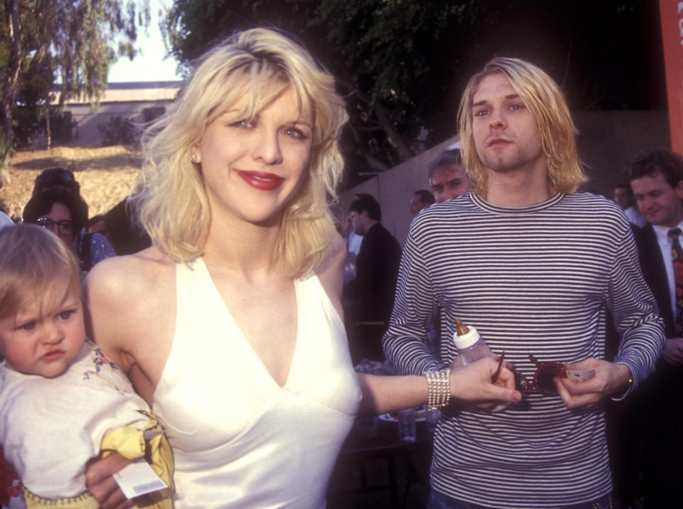 Frances Bean Cobain, Courtney Love and Kurt Cobain of Nirvana (Photo by Barry King/WireImage)