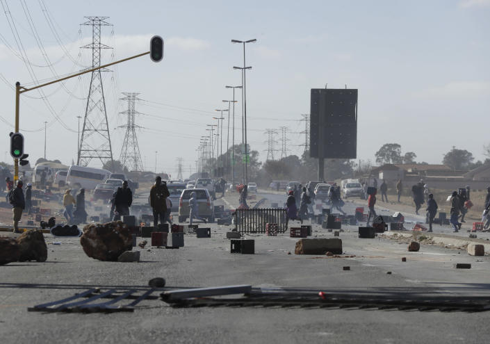 A road is barricaded in Soweto near Johannesburg, Tuesday July 13, 2021 as ongoing looting and violence continues. South Africa's rioting continued Tuesday with the death toll rising to 32 as police and the military struggle to quell the violence in Gauteng and KwaZulu-Natal provinces. The violence started in various parts of KwaZulu-Natal last week when Zuma began serving a 15-month sentence for contempt of court. (AP Photo/Themba Hadebe)
