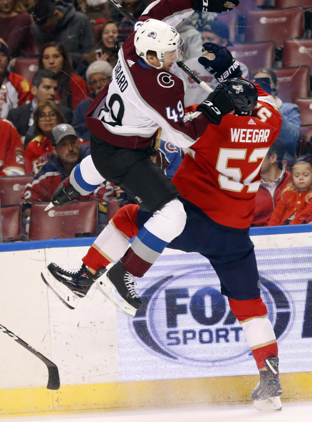 Colorado Avalanche defenseman Samuel Girard (49) and Florida Panthers defenseman MacKenzie Weegar (52) collide during the first period of an NHL hockey game, Thursday, Dec. 6, 2018, in Sunrise, Fla. (AP Photo/Wilfredo Lee)