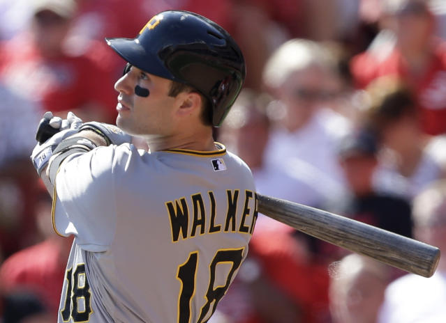 Pittsburgh Pirates' Neil Walker hits a solo home run off Cincinnati Reds starting pitcher Bronson Arroyo in the fifth inning of a baseball game, Saturday, Sept. 28, 2013, in Cincinnati. It was the second home run of the game for Walker. (AP Photo/Al Behrman)